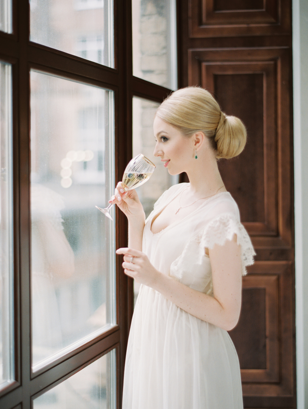 Bride looking at window