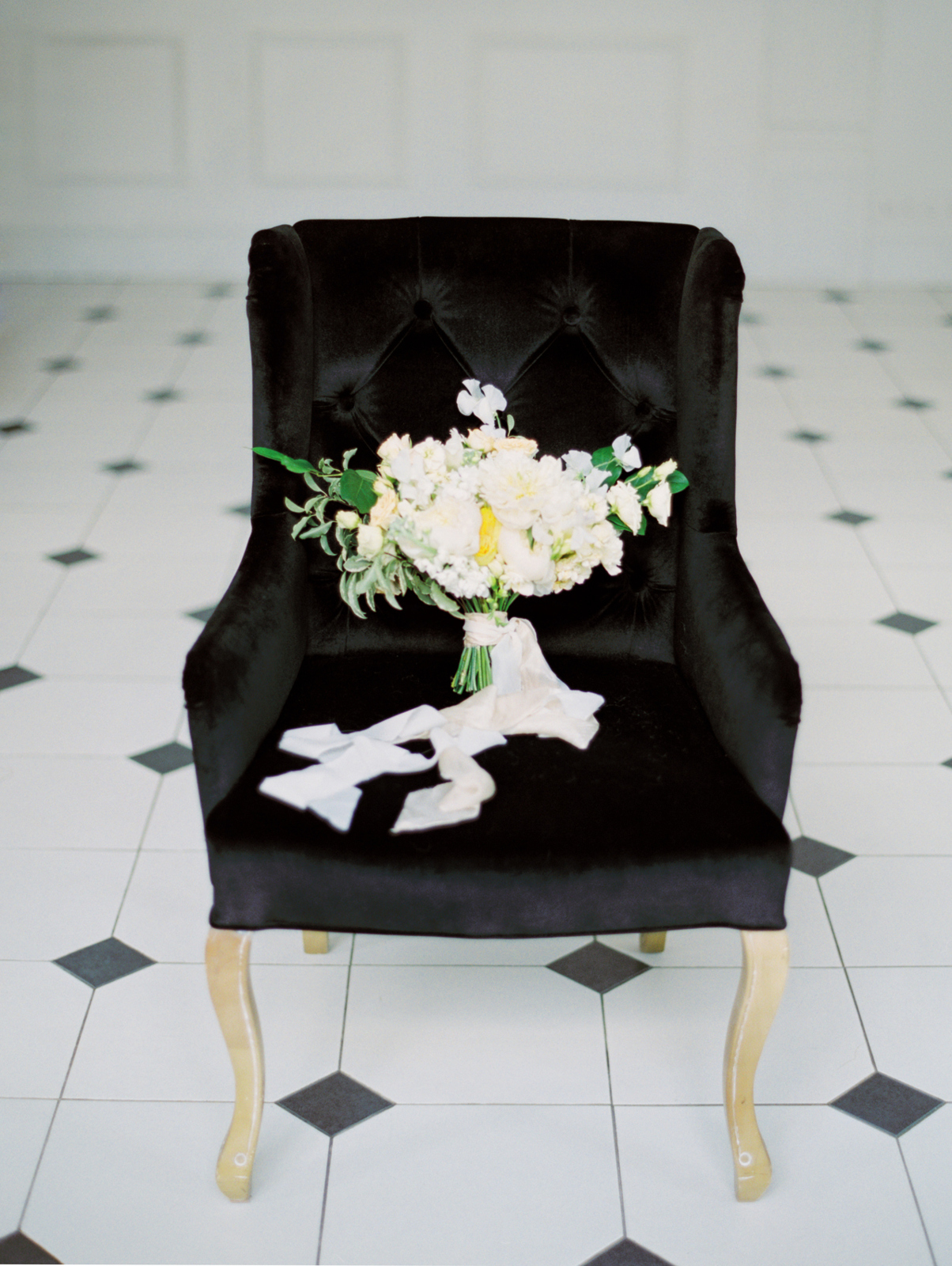 white flowers on black chair