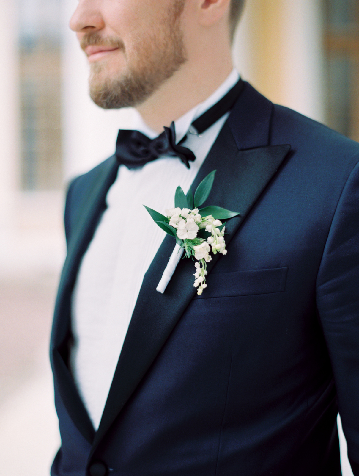 groom's white boutonniere