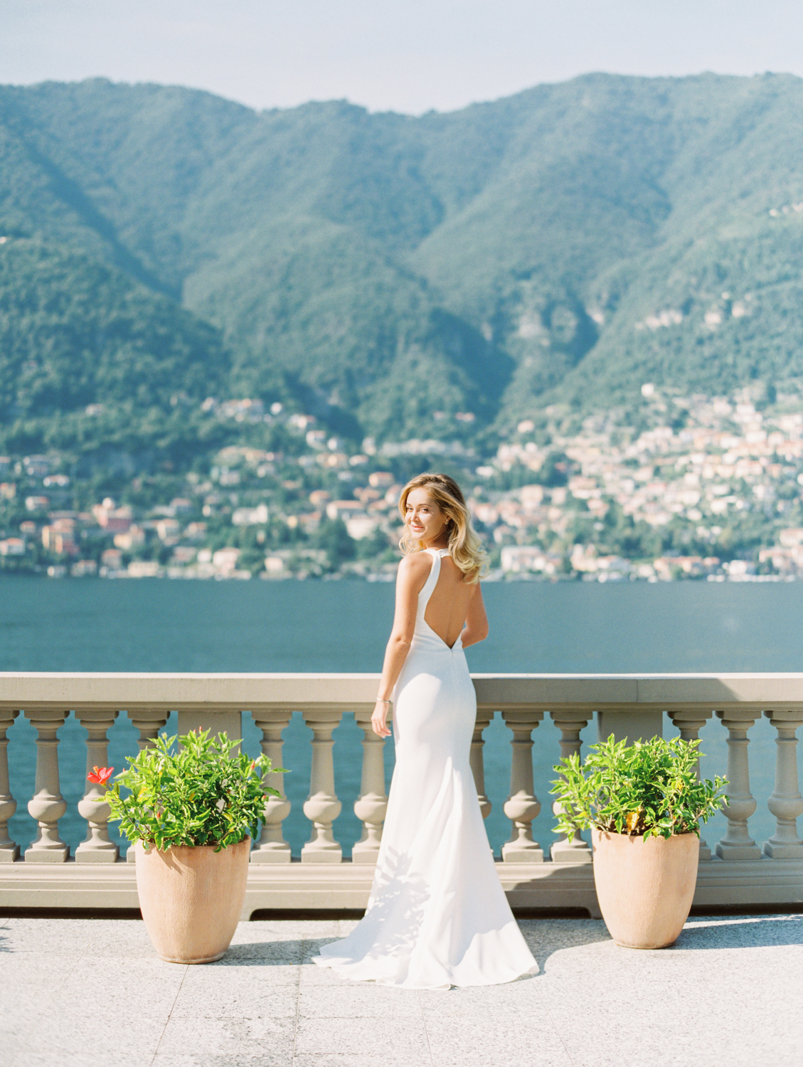 Bride in wedding dress looking at the camera in villa on Lake Como