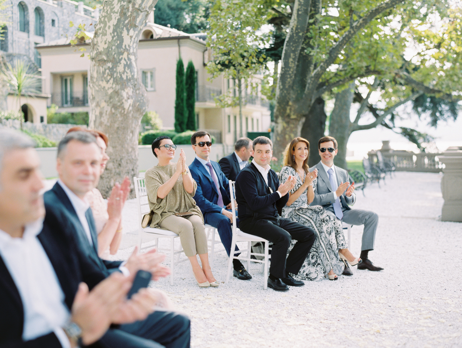Family an friends clap their hands Lake Como Wedding