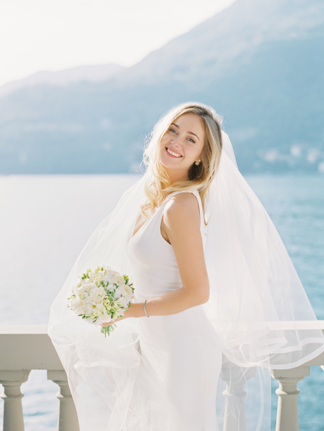 Happy bride with bouquet Lake Como