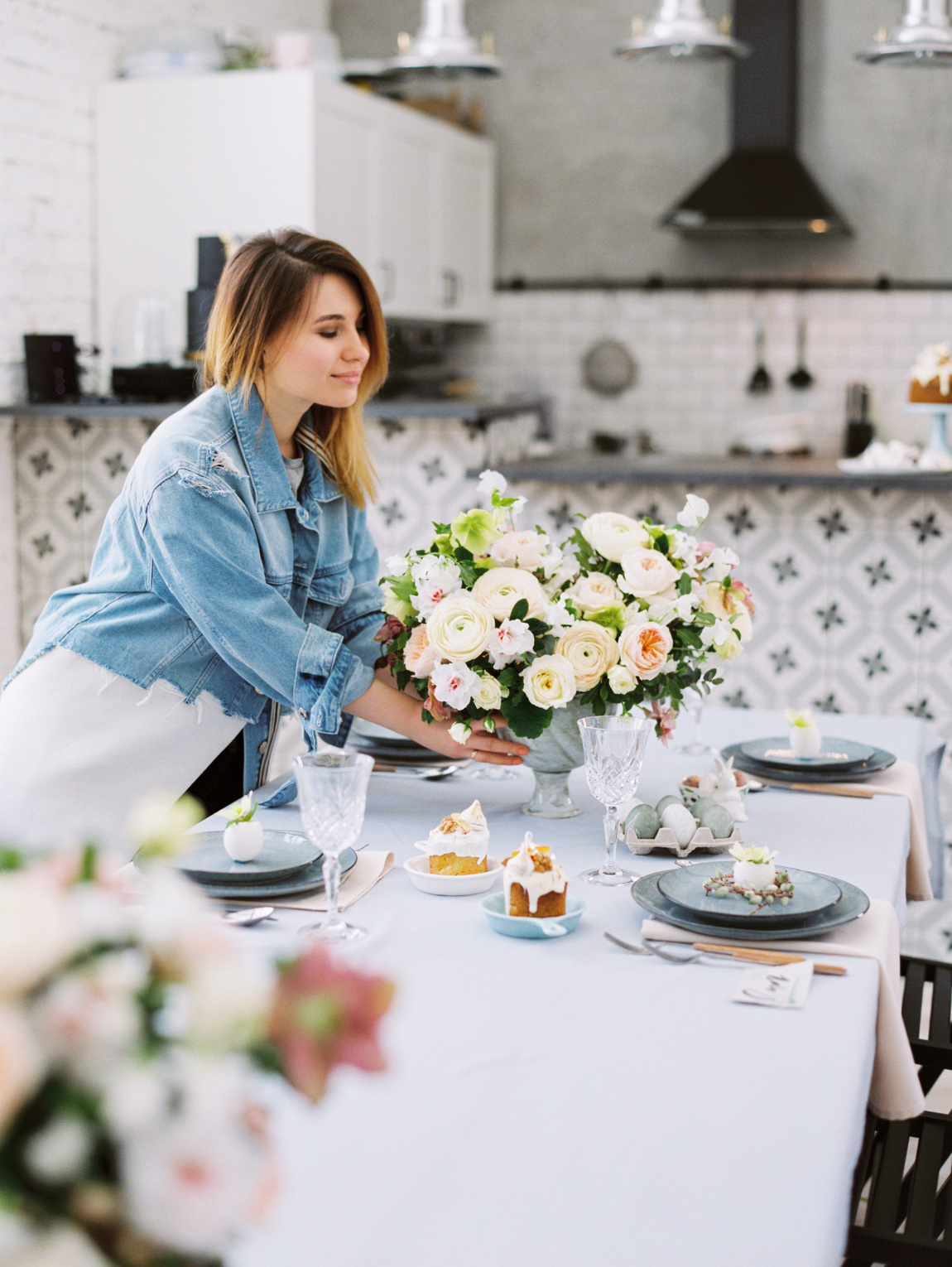 Charming woman setting beautiful easter table